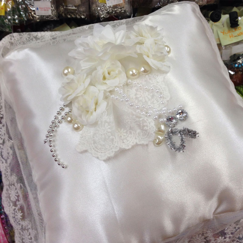 http://www.houseofhwang.com/upload/special/wedding-ring-pillow.jpg
